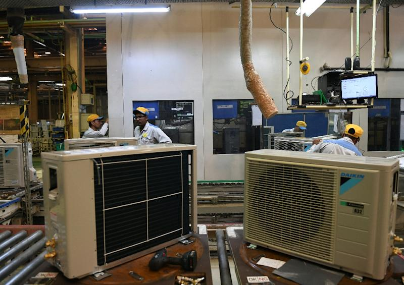 With India's AC market expected to explode, the country could become the planet's top user of electricity for cooling (AFP Photo/Money SHARMA)