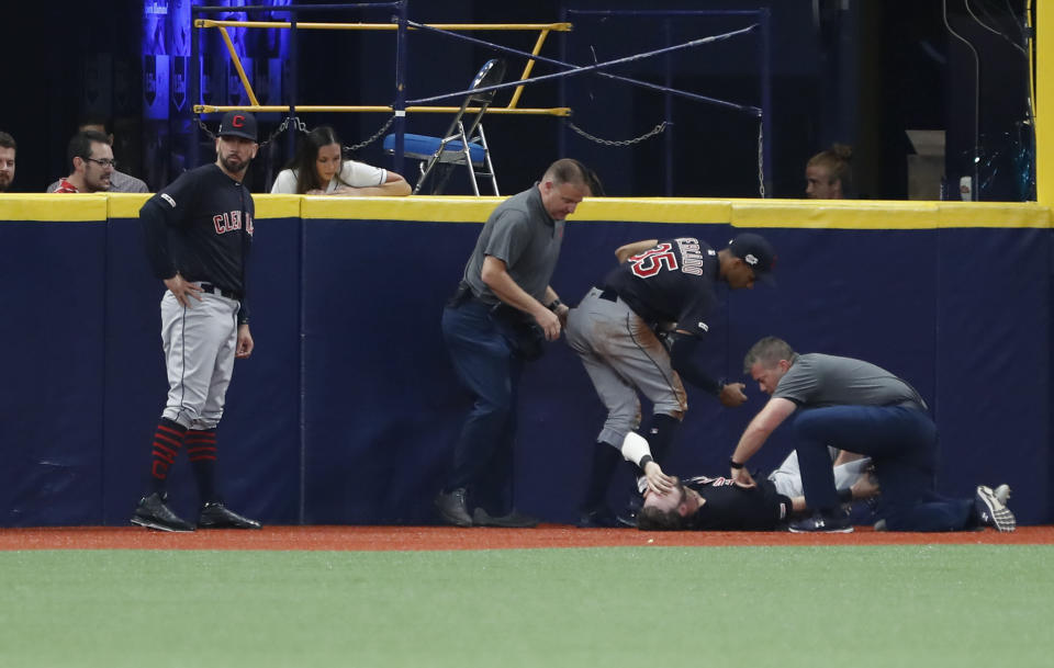 Cleveland Indians left fielder Tyler Naquin lies on the turf after making a catch against the Tampa Bay Rays during the fifth inning of a baseball game Friday, Aug. 30, 2019, in St. Petersburg, Fla. (AP Photo/Scott Audette)