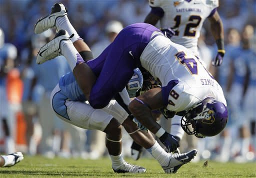 North Carolina's Tre Boston (10) tackles East Carolina's Justin Jones (84) during the first half of an NCAA college football game in Chapel Hill, N.C., Saturday, Sept. 22, 2012. (AP Photo/Gerry Broome)