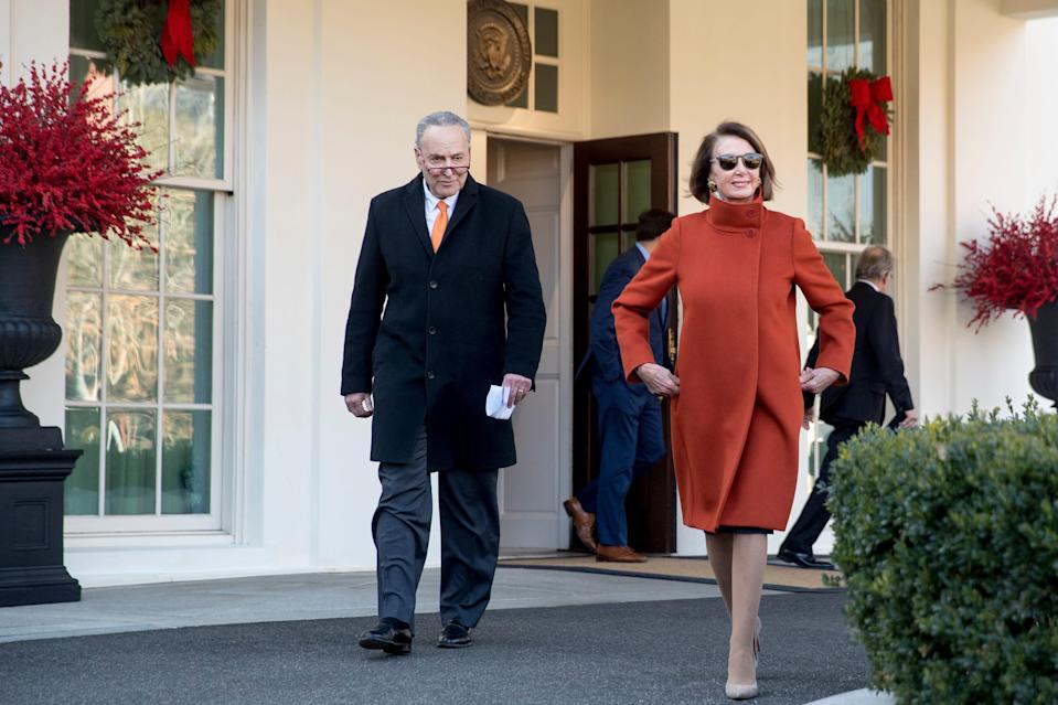 House Minority Leader Nancy Pelosi of Calif., right, and Senate Minority Leader Sen. Chuck Schumer of N.Y., left, walk out of the West Wing to speak to members of the media outside of the White House in Washington, Tuesday, Dec. 11, 2018, following a meeting with President Donald Trump.
