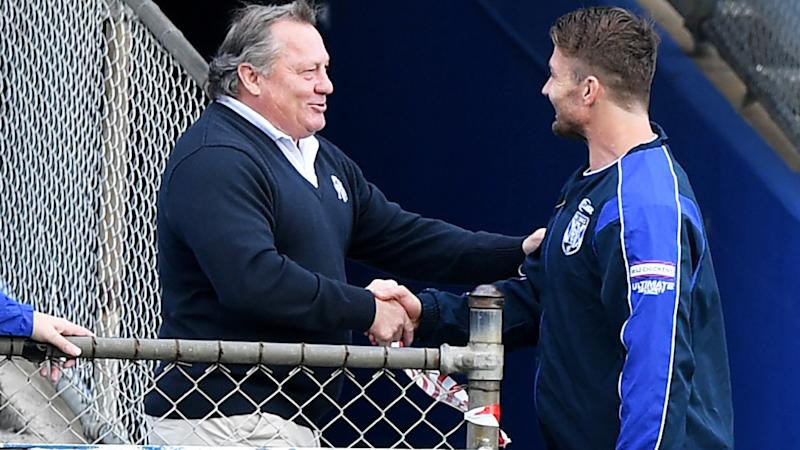 Terry Lamb, pictured here greeting Kieran Foran at a Canterbury-Bankstown Bulldogs training session.