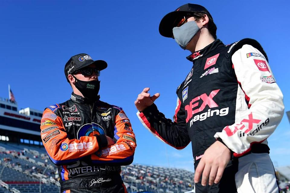 Cousins Jeb Burton and Harrison Burton talk on the grid prior to the NASCAR Xfinity Series Draft Top 250 at Martinsville Speedway on October 31, 2020 in Martinsville, Va.