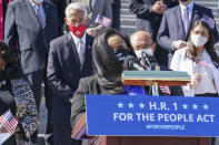 Rep. Nikema Williams, D-Ga, recalls the legacy of Rep. John Lewis as Democrats gather to address reporters on H.R. 1, the For the People Act of 2021, at the Capitol in Washington, Wednesday, March 3, 2021. House Democrats are poised to pass a sweeping elections and ethics bill, offering it up as a powerful counterweight to voting rights restrictions advancing in Republican-controlled statehouses. (AP Photo/J. Scott Applewhite)