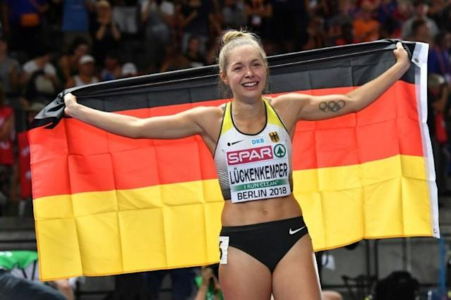 Sprinter Gina Lueckenkemper says the return of the Bundesliga helps give Germans a sense of a return to normality during the COVID-19 pandemic. (AFP Photo/Andrej ISAKOVIC)