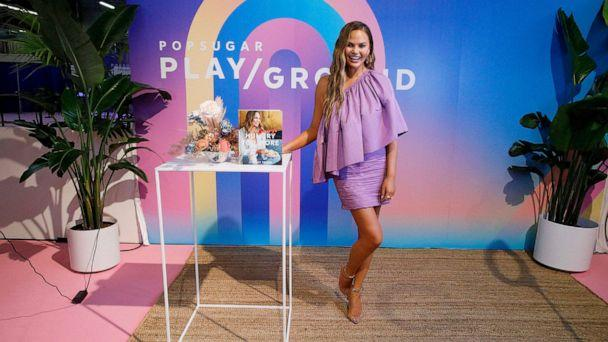 PHOTO: Chrissy Teigen poses with her cookbook during POPSUGAR Play/Ground at Pier 94 on June 23, 2019 in New York City. (Lars Niki/Getty Images,FILE)