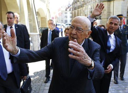 Swiss President Burkhalter and Italy's President Napolitano wave to spectators during a state visit in Ber