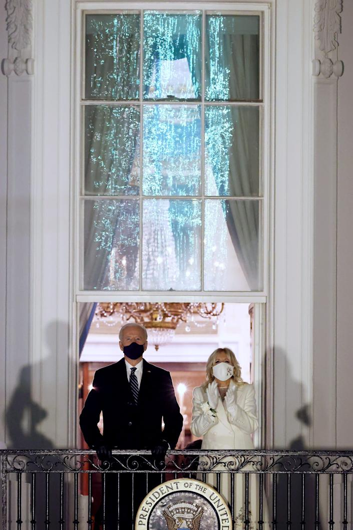 U.S. President Joe Biden and First Lady Dr. Jill Biden watch fireworks at the White House on January 20, 2021 in Washington, DC.  Biden became the 46th president of the United States earlier today during the ceremony at the U.S. Capitol.