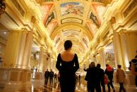 A woman stands inside the shopping mall of the Venetian Macao hotel and casino in Macau
