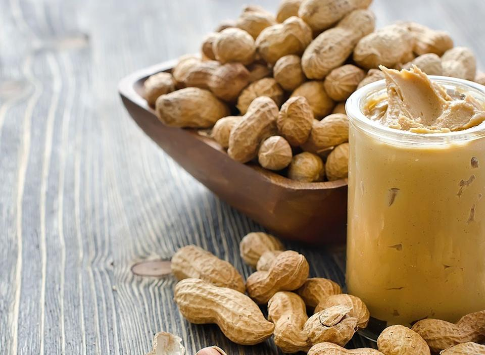 Peanuts in a bowl with peanut butter