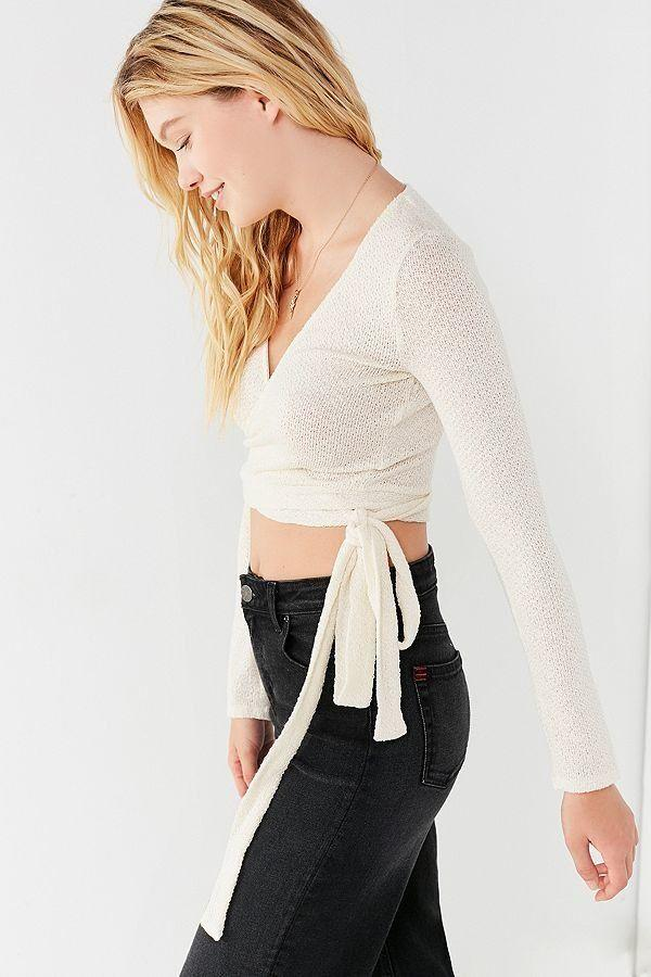 "Get it <a href=""https://www.urbanoutfitters.com/shop/uo-cozy-long-sleeve-cropped-wrap-top"" target=""_blank"">here</a>."