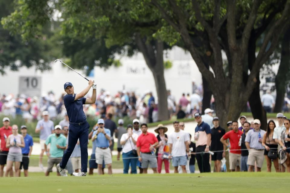 Jordan Spieth and the gallery watch his shot off the seventh fairway during the final round of the Charles Schwab Challenge golf tournament at Colonial Country Club in Fort Worth, Texas, Sunday, May 30, 2021. (AP Photo/Michael Ainsworth)
