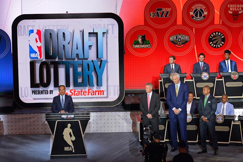 NBA Deputy Commissioner Mark Tatum (left) announces the results of the 2016 NBA Draft Lottery in New York, New York. (David Dow/NBAE/Getty Images)