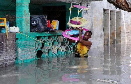 A resident evacuates furniture after rain water flooded his home in Mogadishu, Somalia May 21, 2018. REUTERS/Feisal Omar/Files