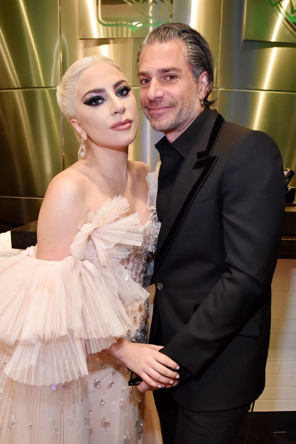 """<p>Gaga and her talent agent fiancé <a href=""""https://people.com/music/lady-gaga-christian-carino-split/"""" rel=""""nofollow noopener"""" target=""""_blank"""" data-ylk=""""slk:ended things in February 2019"""" class=""""link rapid-noclick-resp"""">ended things in February 2019</a>, two years after they were first spotted together at a Kings of Leon concert. The Grammy winner confirmed her engagement to Carino during her <em><a href=""""https://www.elle.com/culture/celebrities/a23833075/lady-gaga-confirms-engagement-to-christian-carino-elle-women-in-hollywood-speech/"""" rel=""""nofollow noopener"""" target=""""_blank"""" data-ylk=""""slk:ELLE"""" class=""""link rapid-noclick-resp"""">ELLE </a></em><a href=""""https://www.elle.com/culture/celebrities/a23833075/lady-gaga-confirms-engagement-to-christian-carino-elle-women-in-hollywood-speech/"""" rel=""""nofollow noopener"""" target=""""_blank"""" data-ylk=""""slk:Women in Hollywood acceptance speech"""" class=""""link rapid-noclick-resp"""">Women in Hollywood acceptance speech</a> the October prior to their split. She's since moved on <a href=""""https://www.elle.com/culture/celebrities/a30750971/who-is-michael-polansky-lady-gaga-boyfriend/"""" rel=""""nofollow noopener"""" target=""""_blank"""" data-ylk=""""slk:with investor Michael Polansky"""" class=""""link rapid-noclick-resp"""">with investor Michael Polansky</a>.<br></p>"""