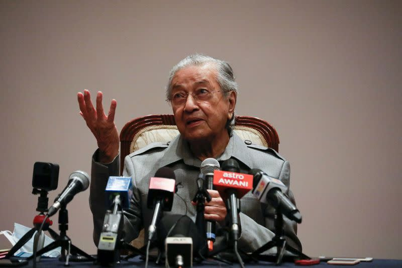 Malaysia's ruling party dumps Mahathir, dissenters