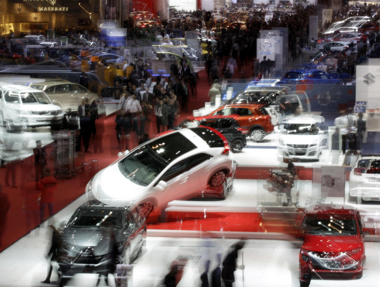 In this long-time exposed picture a general view is photographed at hall 5 on Wednesday, March 7, 2012 during the press preview days at the 82nd Geneva International Motor Show in Geneva, Switzerland.The Motor Show will open it's doors to public from 8th to the 18th of March presenting more than 260 exhibitors and more than 180 world and European premieres. (AP Photo/Frank Augstein)