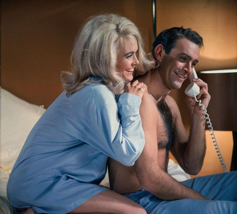 <p>Sean Connery and Shirley Eaton share a laugh on the phone in the Goldfinger.</p>