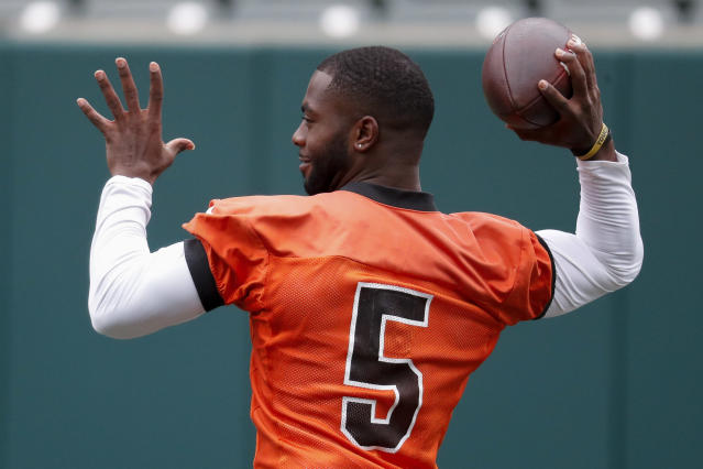 Ohio State quarterback J.T. Barrett practices during the Cincinnati Bengals NFL football team pre-draft workouts with local players from the surrounding region, Tuesday, April 17, 2018, in Cincinnati. (AP Photo/John Minchillo)