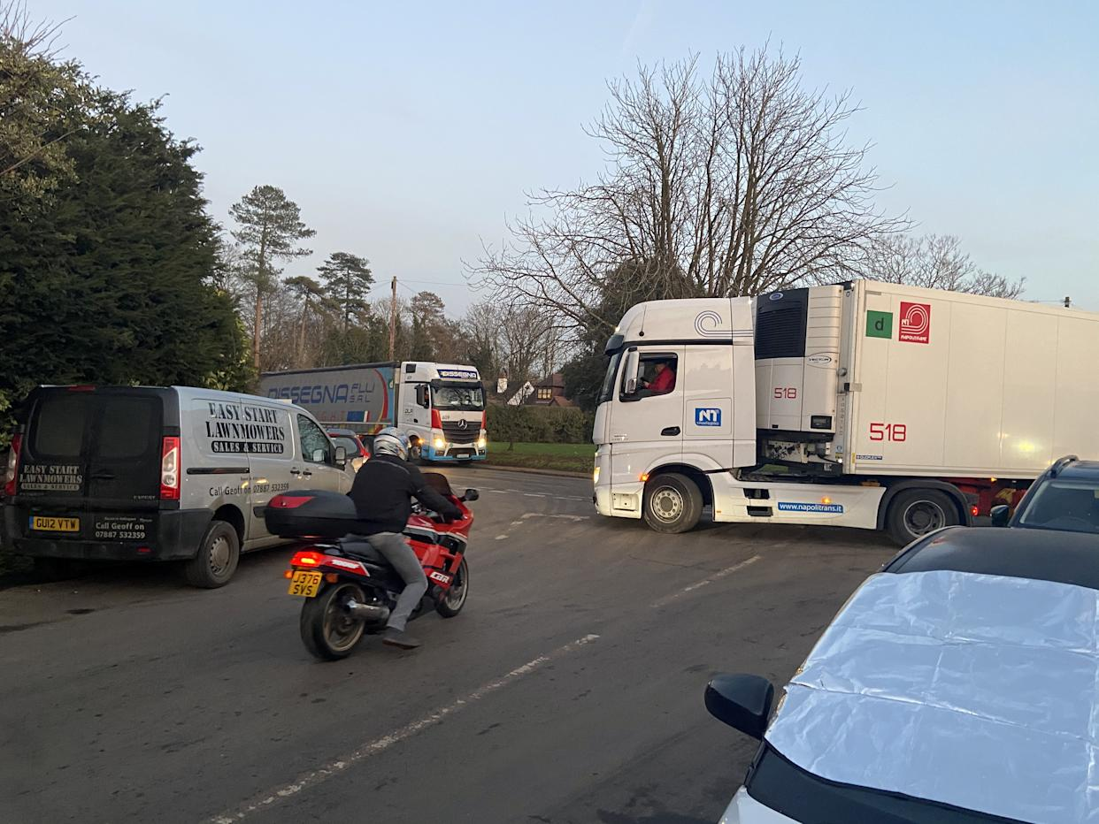 Lorries in the small village of Mersham near Ashford, Kent. See SWNS copy NNvillage: Lost truckers are clogging up a small village because the government is giving them the wrong postcode for their new Brexit lorry park. Frustrated residents living in Mersham near Ashford, Kent, have seen their narrow country lanes blocked by HGVs that have been given incorrect directions. Around 30 lorries arrived in the village since the 66-acre lorry park opened for coronavirus testing on Monday.