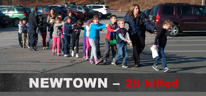 Two Connecticut State Police officers accompany a class of students and two adults out of Sandy Hook Elementary School on Dec. 14, 2012, in Newtown, Conn. (Photo: Shannon Hicks/Newtown Bee/Polaris)