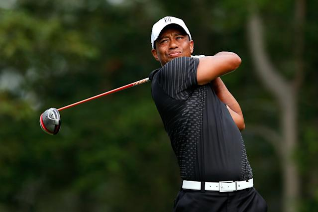 FARMINGDALE, NY - AUGUST 23: Tiger Woods watches his tee shot on the 16th hole during the First Round of The Barclays on the Black Course at Bethpage State Park August 23, 2012 in Farmingdale, New York. (Photo by Kevin C. Cox/Getty Images)