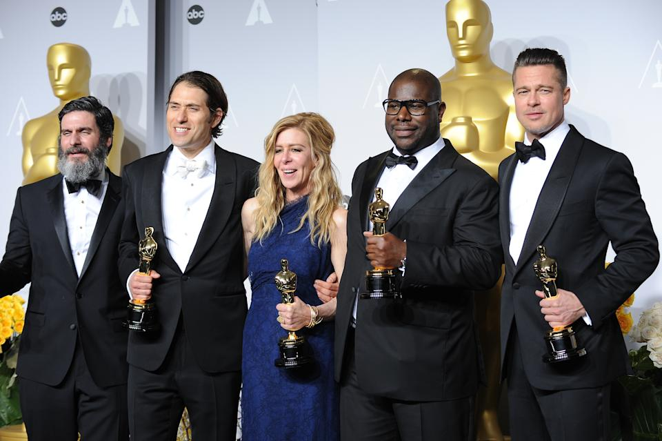 """(L-R) Producers Anthony Katagas, Jeremy Kleiner, Dede Gardner, director Steve McQueen and Brad Pitt, winners of Best Picture for """"12 Years a Slave"""", pose in the press room at Loews Hollywood Hotel. (Photo by Frank Trapper/Corbis via Getty Images)"""