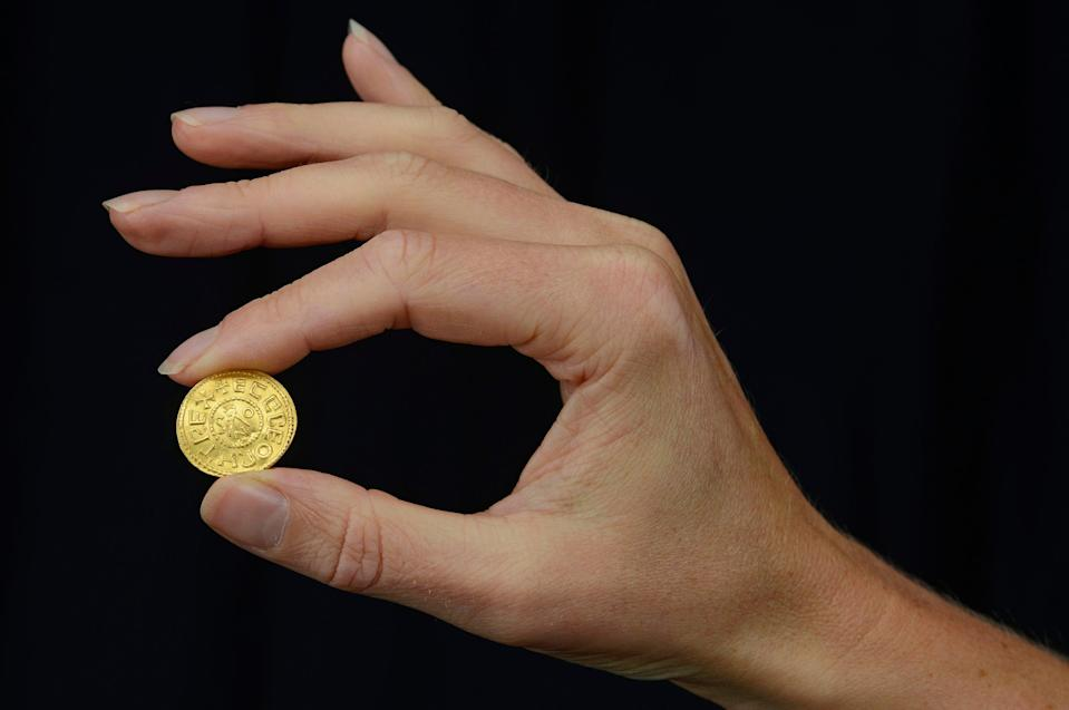 An Anglo-Saxon coin discovered by a metal detectorist which is set to fetch up to £200,000 at auction (PA)