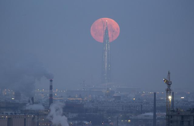 <p>A full moon is seen behind the business tower Lakhta Center, which is under construction in St. Petersburg, Russia, Jan. 31, 2018. (Photo: Anton Vaganov/Reuters) </p>