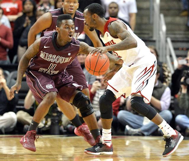 Missouri State's Marcus Marshall, left, presses Louisville's Russ Smith during the first half of an NCAA college basketball game Tuesday, Dec. 17, 2013, in Louisville, Ky. (AP Photo/Timothy D. Easley)