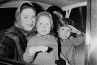 <p>From the backseat of their car, Princess Margaret smiles, while her children David and Sarah make faces at the photographers through the window in 1968. </p>