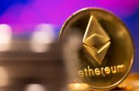 FILE PHOTO: A representation of virtual currency Ethereum is seen in front of a stock graph in this illustration
