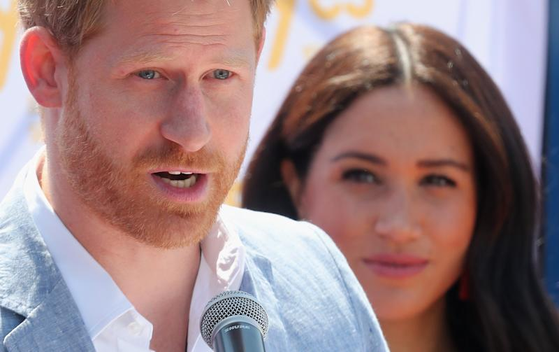 Meghan, Duchess of Sussex looks on as Prince Harry, Duke of Sussex speaks during a visit a township to learn about Youth Employment Services on October 02, 2019 in Johannesburg, South Africa.. (Photo by Chris Jackson/Getty Images)