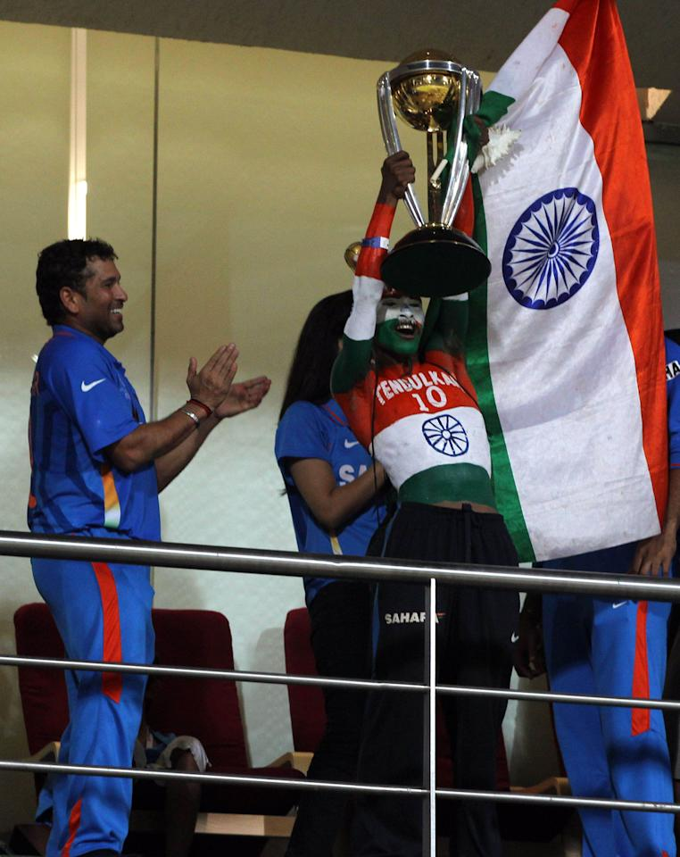 MUMBAI, INDIA - APRIL 2:   Indian cricket fan Sudhir Kumar Gautam lifts the 2011 ICC World Cup trophy as Indian cricketer Sachin Tendulkar appluds him after India won the final beating Sri Lanka by 6 wickets at Wankhede stadium in Mumbai, India on April 2, 2011. (Photo by Santosh Harhare/Hindustan Times via Getty Images)
