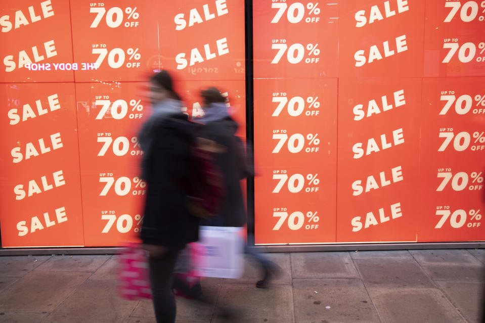People out shopping on Oxford Street walk past large scale January sale signs in red and white for major high street clothing retail shops on 7th January 2019 in London, United Kingdom. Its time for the Winter sales, and most shops are advertising big reductions in prices. Bargains are available and the shopping streets are busy. Oxford Street is a major road in the West End of London. It is Europe's busiest shopping street, with around half a million daily visitors, and has approximately 300 shops. (photo by Mike Kemp/In Pictures via Getty Images Images)