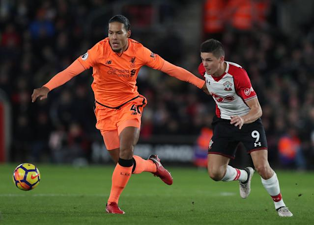 "Soccer Football - Premier League - Southampton vs Liverpool - St Mary's Stadium, Southampton, Britain - February 11, 2018 Liverpool's Virgil van Dijk in action with Southampton's Guido Carrillo Action Images via Reuters/Peter Cziborra EDITORIAL USE ONLY. No use with unauthorized audio, video, data, fixture lists, club/league logos or ""live"" services. Online in-match use limited to 75 images, no video emulation. No use in betting, games or single club/league/player publications. Please contact your account representative for further details."