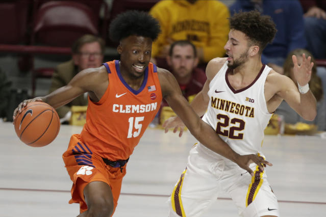 Clemson forward John Newman III (15) drives against Minnesota guard Gabe Kalscheur (22) in the first half during an NCAA basketball game Monday, Dec. 2, 2019, in Minneapolis. (AP Photo/Andy Clayton-King)