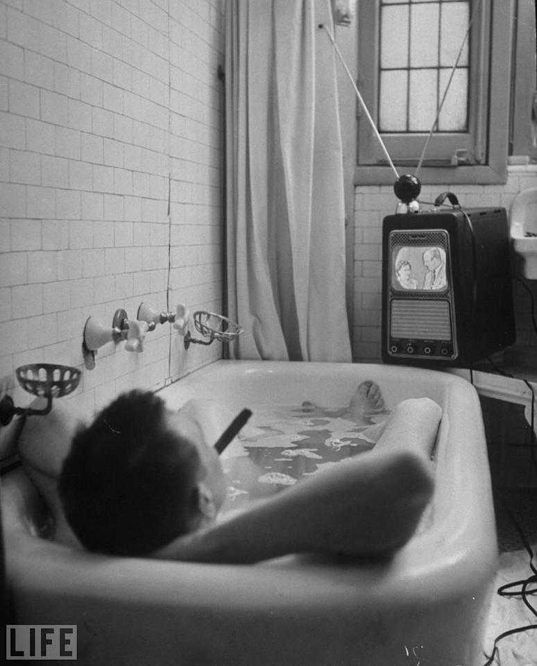 Writer Russell Finch enjoys a smoke and a bath and a program.  George Skadding/Time & Life Pictures/Getty Images