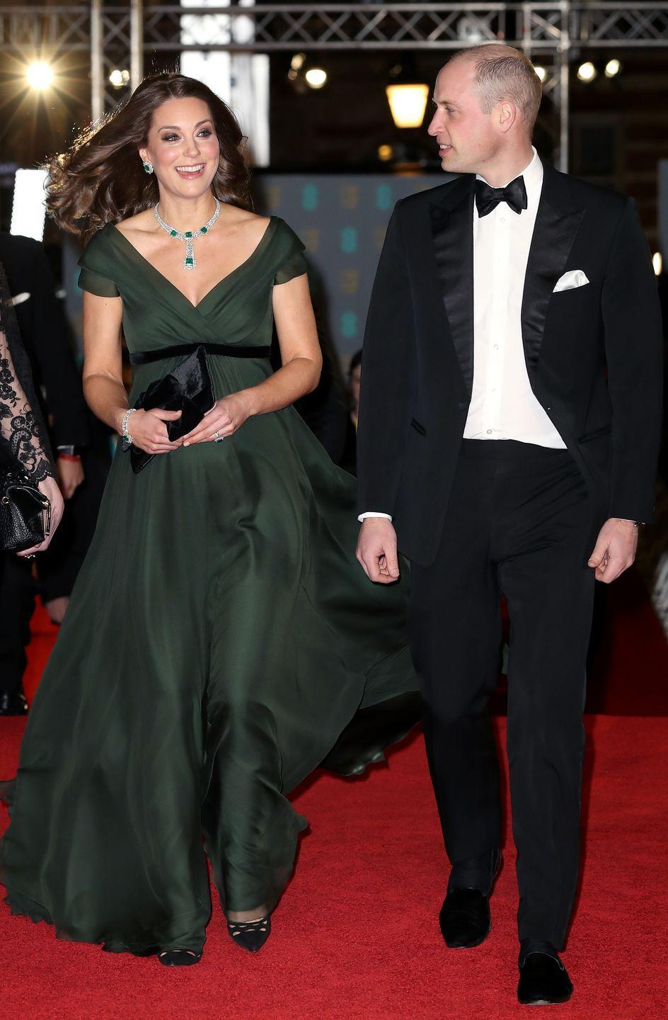 """<p>Duchess Kate and Will dressed up for a night out at the BAFTA Awards in London. Despite <a href=""""https://www.townandcountrymag.com/style/fashion-trends/a16868409/kate-middleton-baftas-black-dress-times-up/"""" rel=""""nofollow noopener"""" target=""""_blank"""" data-ylk=""""slk:the BAFTA's all-black dress code in support of the #TimesUp movement"""" class=""""link rapid-noclick-resp"""">the BAFTA's all-black dress code in support of the #TimesUp movement</a>, the Duchess wore a green Jenny Packham gown with emerald jewelry, Prada heels, and a black clutch.</p>"""