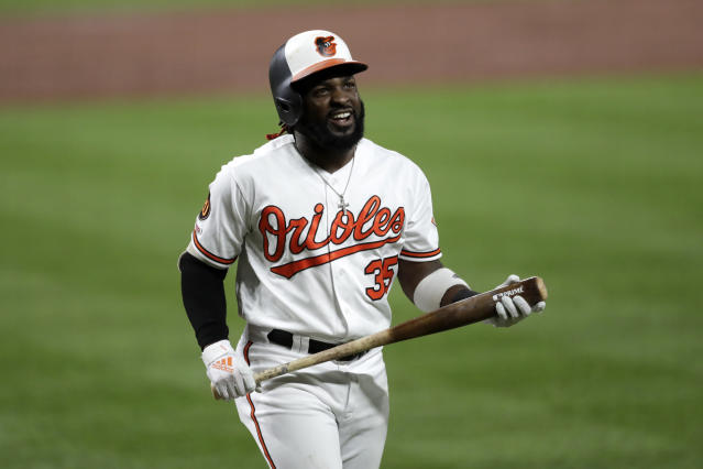 Baltimore Orioles' Dwight Smith Jr. reacts after striking out to Toronto Blue Jays pitcher Trent Thornton during the third inning of a baseball game Tuesday, Sept. 17, 2019, in Baltimore. (AP Photo/Julio Cortez)