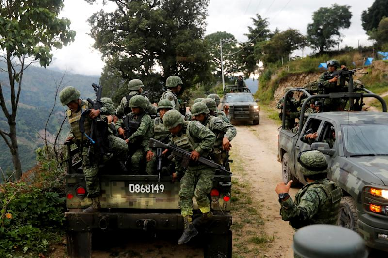Soldiers arrive at the area where they found an illegal opium plantation
