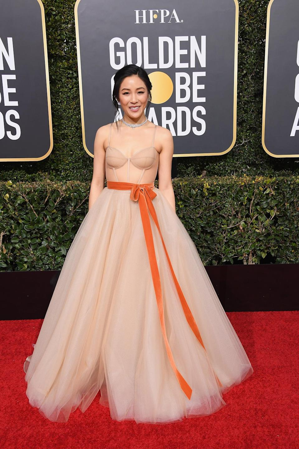 <p>Wearing a Vera Wang dress with Messika jewels.</p>