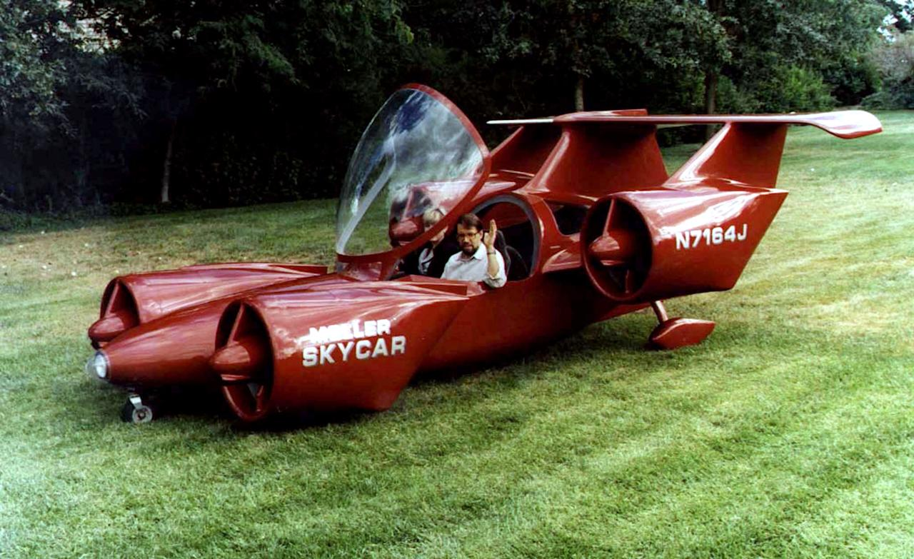 "Inventor Paul Moller sits in a prototype of his new Skycar, a personal ""vertical takeoff and landing"" vehicle which will start its first flights tests over the next several months. The Skycar, made by Moller International, now costs an estimated $1 million to produce -- but company officials hope eventually to bring the price tag down to around $50,000 dollars. Reuters"