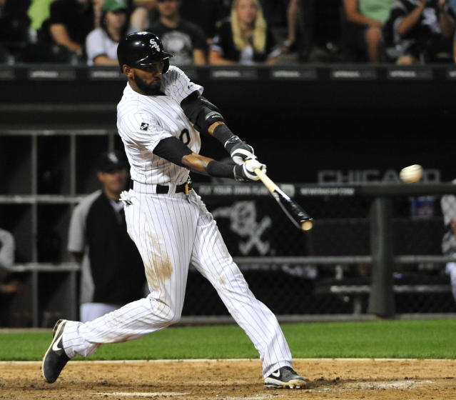 Chicago White Sox's Alexei Ramirez hits an RBI double against the Minnesota Twin during the sixth inning of a baseball game, Friday, Aug. 1, 2014, in Chicago. (AP Photo/David Banks)