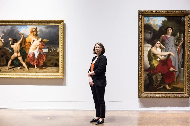 "Dr. Rosamund Garrett, the new Brooks associate curator, stands in the soon to be open exhibition titled ""Bouguereau & America,"" June 17, 2019. The exhibition contains 39 paintings by William Adolphe-Bouguereau and runs from June 22 to September 22 at the Memphis Brooks Museum of Art."