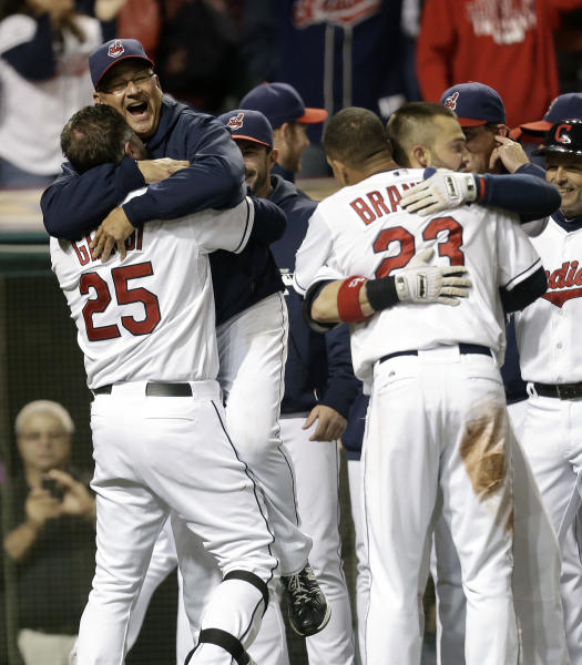 Cleveland Indians designated hitter Jason Giambi, left, picks up manager Terry Francona after Giambi hit a two-run home run off Chicago White Sox relief pitcher Addison Reed in the ninth inning of a baseball game, Tuesday, Sept. 24, 2013, in Cleveland. Michael Brantley scored. The Indians won 5-4. (AP Photo/Tony Dejak)