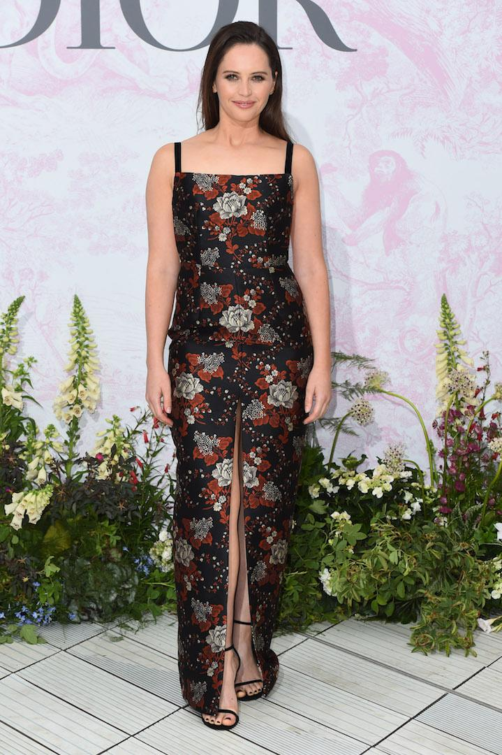 Felicity Jones opted for a floral number (complete with a thigh-split) by Markarian for the starry evening in Kensington. <em>[Photo: Getty]</em>