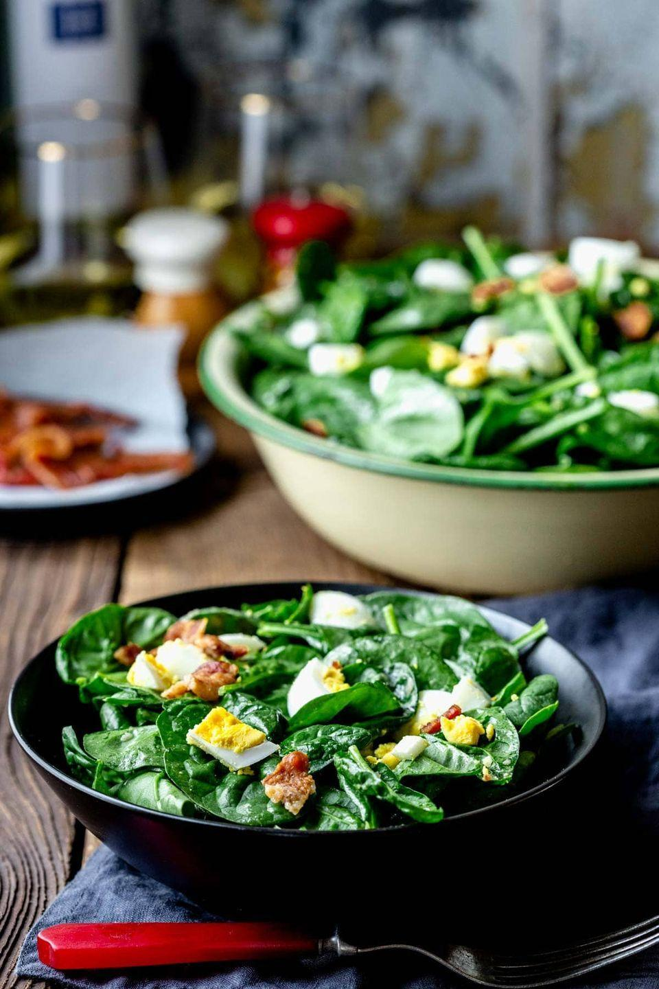 """<p>You can make this salad up to a day ahead; just keep the salad dressing in a separate jar and toss when you're ready to serve.</p><p><strong>Get the recipe at <a href=""""https://www.healthyseasonalrecipes.com/spinach-salad-with-bacon-eggs/"""" rel=""""nofollow noopener"""" target=""""_blank"""" data-ylk=""""slk:Healthy Seasonal Recipes"""" class=""""link rapid-noclick-resp"""">Healthy Seasonal Recipes</a>. </strong></p>"""