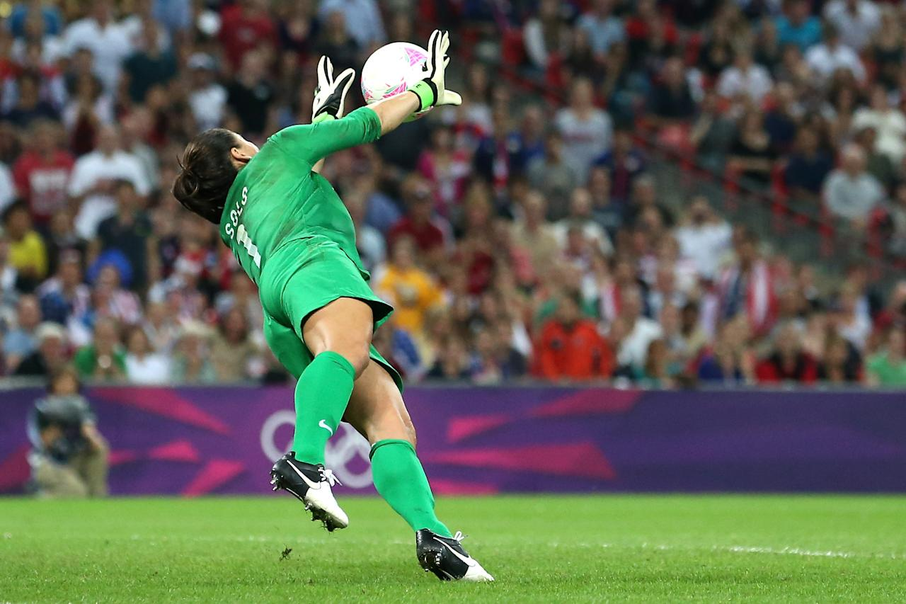LONDON, ENGLAND - AUGUST 09:  Goalkeeper Hope Solo #1 of United States makes a save in the first half while taking on Japan during the Women's Football gold medal match on Day 13 of the London 2012 Olympic Games at Wembley Stadium on August 9, 2012 in London, England.  (Photo by Ronald Martinez/Getty Images)