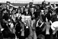 FILE - In this June 5, 1968, file photo, Sen. Robert F. Kennedy addresses campaign workers moments before being shot in Los Angeles. At his side are his wife, Ethel, and his California campaign manager, Jesse Unruh, speaker of the California Assembly. Prosecutors for the first time are not opposing the release of Sirhan Sirhan. The 77-year-old prisoner on Friday, Aug. 27, 2021, faces his 16th parole hearing for fatally shooting Kennedy in 1968. (AP Photo/Dick Strobel, File)