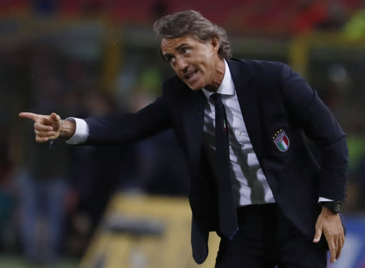 FILE - In this Friday, Sept. 7, 2018 file photo, Italy coach Roberto Mancini gestures during the UEFA Nations League soccer match between Italy and Poland at Dall'Ara stadium in Bologna, Italy. Italy coach Roberto Mancini has tested positive for the coronavirus days before the international break. The Italian soccer federation says that Mancini is completely asymptomatic and is self-isolating at his house in Rome. The Italy squad will meet up on Sunday. It plays an international friendly against Estonia on Wednesday and hosts Poland in the Nations League four days later. (AP Photo/Antonio Calanni, File)
